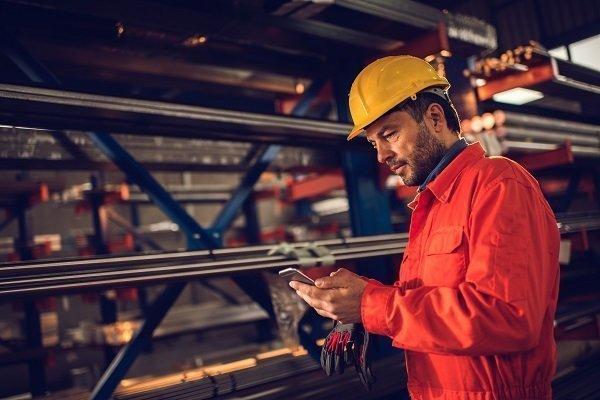 Maintenance worker logging work orders via phone
